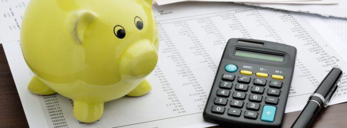A piggy bank and a calculator