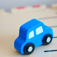 Wooden blue toy car on wooden platform