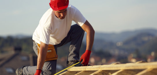 construction worker on roof of home