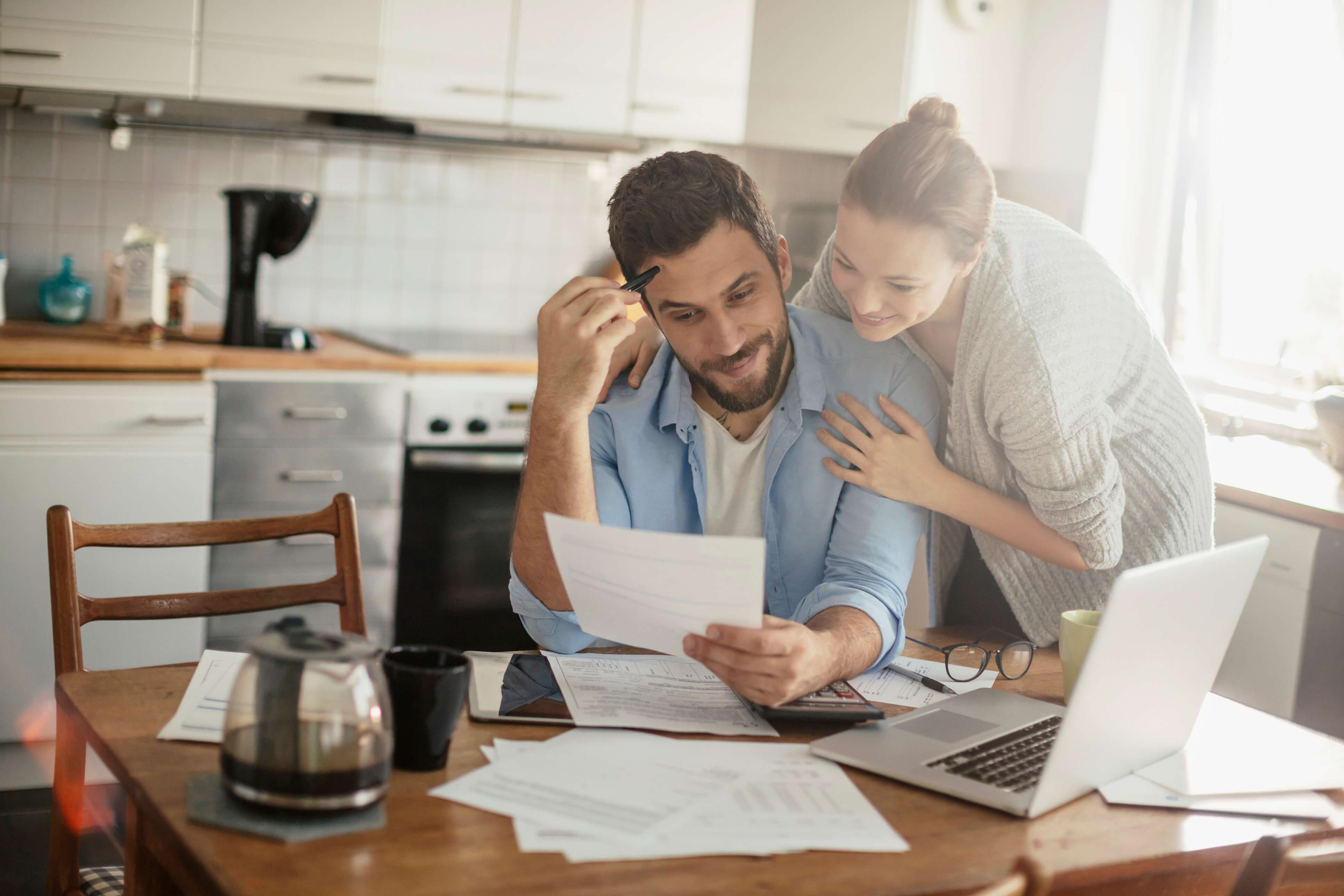 couple looking over their debt